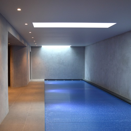 This pool area features soft grey walls splash proofed with Tadelakt